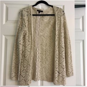 Beige colored knit cardigan with holes